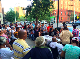 Photo // Charlotte Gibson East Harlem locals gather on 118th Street and Pleasant Avenue to protest the recent development plans to build luxury towers atop East River Plaza.
