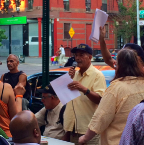 Photo // Charlotte Gibson Robert Anazagasti calls on the community of East Harlem to fight back against developers.